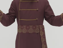 Burgundy polyester Anglican Cassock with old gold piping, Salvatore Burgundy/gold brocade, frock cuffs and shoulder epilauts. Military corded accents and large buttons