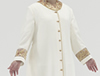 Cream polyester Roman style cassock with old gold piping, old gold cloth covered buttons, small Coronation Red/Gold/Purple brocade featured as a strip on a straight sleeve